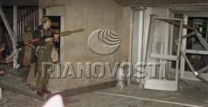 A man with a grenade-gun near the Ostankino TV Centre entrance. October 3, 1993. © Igor Mikhalev, Ria Novosti, 1993.