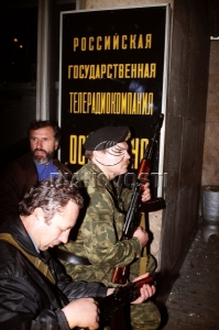 People with AK near the Ostankino TV Centre entrance. October 3, 1993. © Igor Mikhalev, Ria Novosti, 1993.
