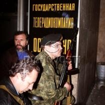 People with AK near the Ostankino TV Centre entrance. October 3, 1993. © Igor Mikhalev, Ria Novosti, 1993.