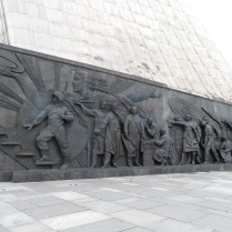 A sculptural panel depicting Soviet scientists and engineers, Yuri Gagarin, the first man in space, and the image of Mother Motherland (aka Mother Russia) holding hammer and sickle