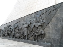 A sculptural panel depicting Soviet scientists and engineers, and Vladimir Lenin