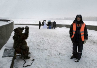 Typical meanwhile in Russia photo: Bear drinking vodka