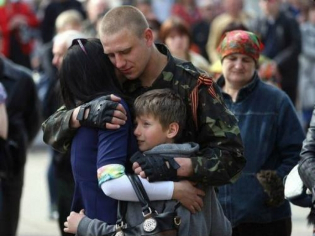Family embrace before a self-defense fighter departs to the frontline