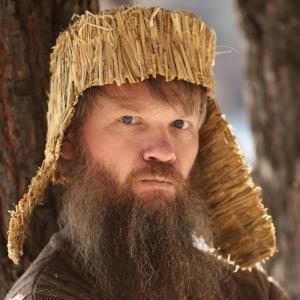 Vasily Slonov posing as 'crazy Russian muzhik' in a straw ushanka
